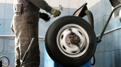 Wheel balance automobile repair shop fast motion. Automobile repair shop Stock Footage