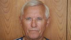 Senior man with false teeth smiling Stock Footage