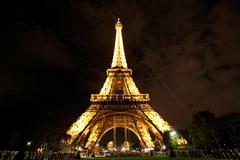 PARIS. Eiffel Tower illuminating Stock Photos