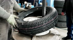 Mounting Tire On The Rim, Car mechanic mounting tire on alloy wheel, Mechanic Stock Footage