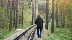 Russia, Novosibirsk, 5 october 2016, Alone man walking on Railway Road in the Stock Footage