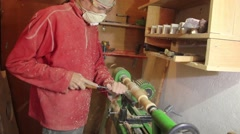 Foot operated spring pole wood lathe. Man operating a foot operated spring pole Stock Footage