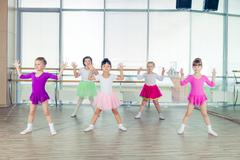 Happy children dancing on in hall, healthy life, kid's togethern Kuvituskuvat