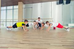 Group of children doing kids gymnastics in gym with nursery teac Kuvituskuvat