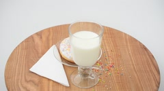 Donut and milk on a kitchen board. Stock Footage