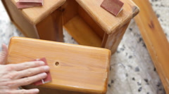 Sanding wooden furniture with sandpaper Stock Footage