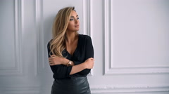 Glamour fashion business style beautiful woman posing in modern studio Stock Footage