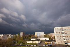 Storm clouds in the city Stock Photos