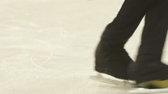 Little skaters train on the ice Stock Footage