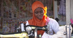 Ghanian woman Sewing Stock Footage