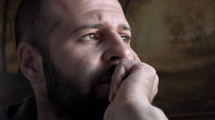 Young man deep in thought Stock Footage