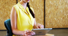 Female business executive using digital tablet Stock Footage