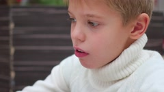 A child drinks from a straw carbonated drink closeup Stock Footage