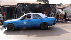 Traffic and people in  city market Bandim - Guinea Africa Stock Footage