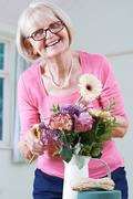 Senior Woman In Flower Arranging Class Stock Photos
