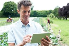 Male Agricultural Worker Using Digital Tablet In Field Stock Photos