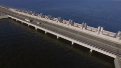 Aerial view of the truck, which rides on the dam around the water. This route is Stock Footage