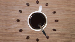 Coffee Time - Cup of coffee and clock of coffee beans Stock Footage