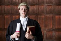 Portrait Of Lawyer In Court Holding Brief And Book Stock Photos