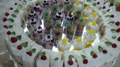 Delicious decorated sweets on buffet table, cocktails party catering Stock Footage