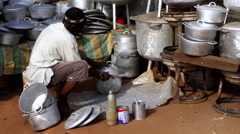 Africa market Shop selling kitchen tools made of soda cans - Guinea Africa Stock Footage
