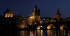 The Charles Bridge with tourists walking Stock Footage