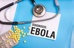 Ebola word written on medical blue folder with patient files, pills and steth Kuvituskuvat