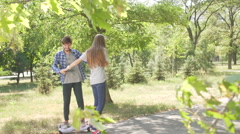 Couple whirls on hoverboards. Close up shot Stock Footage