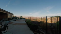 Time Lapse: Morning Sun Rising over Pool and Spa Area Residentail Stock Footage