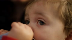 Close up on an adorable little boy on his mom's lap Stock Footage