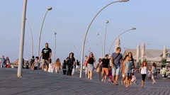 Tourists and Locals at Old Tel Aviv Port promenade Stock Footage
