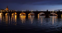 White swans and ducks swimming in Vltava river over the Charles Bridge Stock Footage