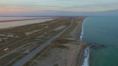 Aerial (drone) 4K HD video of flying on the beach Stock Footage