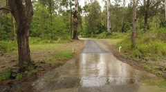 Aerial Shot of 4WD Driving Through Water On Australian Road Stock Footage