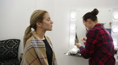 Make-up artist doing make-up Stock Footage