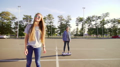 Young man and woman riding on the Hoverboard. Content technologies. Stock Footage