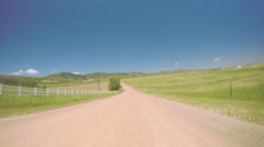 Car driving on rural dirt road in South Denver, near Chatfield State Park. Stock Footage