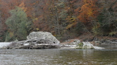 Rocks at Isar river next to Pullach in Bavaria. Near Munich. (Germany) Stock Footage