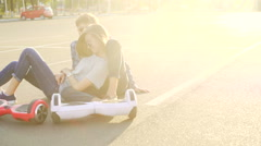Lifestyle of modern young man and woman. Hoverboard wide shot Stock Footage