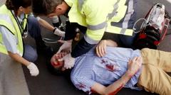 Paramedic using an external defibrillator during cardiopulmonary resuscitation Arkistovideo