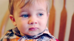 Adorable baby boy looking off into the distance and then smiling Stock Footage