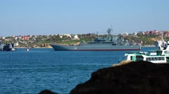 Civilian ships on a background of military cruiser in Sevastopol. Russian army. Arkistovideo