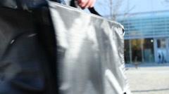 Handbag on business man Stock Footage