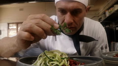 Male chef garnishing food Stock Footage