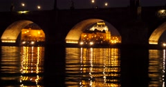 The Charles Bridge arches, birds flying Stock Footage