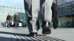 Business man walks with handbag Stock Footage