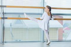 Little ballerina girl. Adorable child dancing classical ballet i Stock Photos