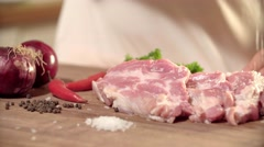 Piece of Pork Rubbed with Salt Male Hands on a Wooden Board. HD Video Clip. The Stock Footage