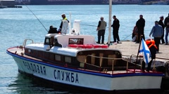 Fishermen on the wharf, sunny weather. Sevastopol Crimea. Stock Footage