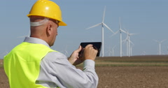 Engineer Use Touch Tablet Check Wind Turbine Efficiency and Production Capacity Stock Footage